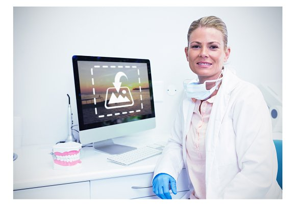 Dentist On Computer At Desk Mockup