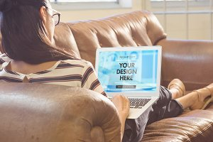 Woman On Sofa With Laptop Mockup