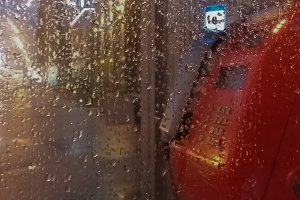 Rain and a telephone booth.