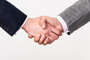 Two business men handshaking