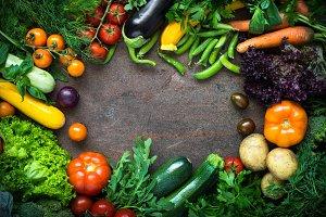 Organic farmer vegetables on dark slate table.