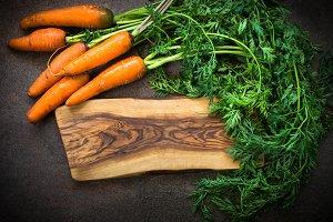 Carrots on dark stone table.
