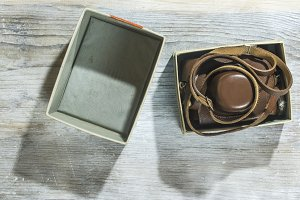 Vintage photo camera on wooden backg