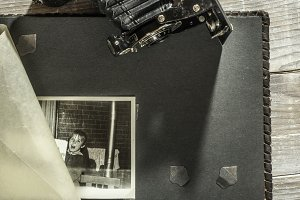 Vintage photo camera and album