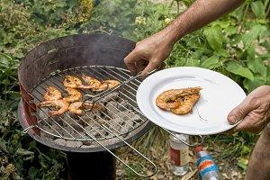 Grilling prawns in garden
