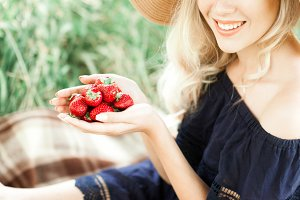 Woman holding strawberry