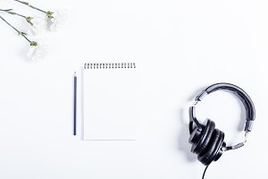 notebook, pencil, headphones