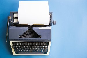 Typewriter on blue background