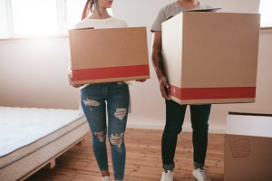 Couple with big cardboard boxes