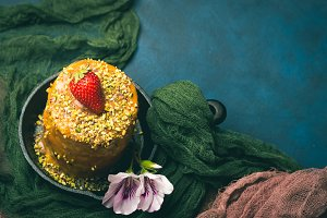 Caramel cake with strawberry pistachio flowers