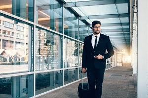 Business traveler with suitcase