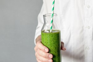 Man holding green smoothie