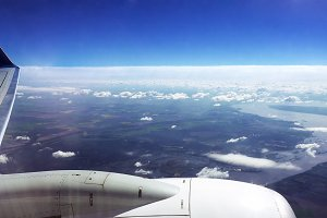 Flying over the clouds in a plane aircraft