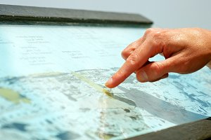 Hands forefingers pointing places on touristic map