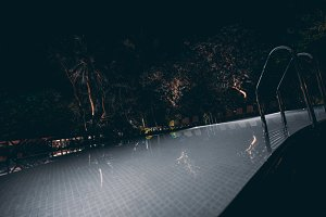 Swimming pool at resort at night