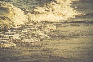 Closeup of Waves Crashing on Beach