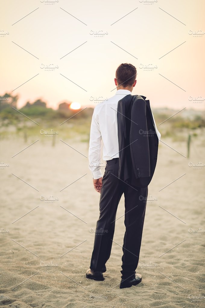 sunset_businessman.jpg - Business