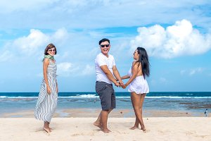 Group of multiracial friends having fun on the beach of tropical Bali island, Indonesia.