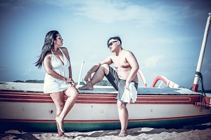 Asian couple on the beach of tropical Bali island, Indonesia.