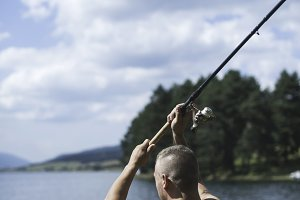 Man on fishing with rod
