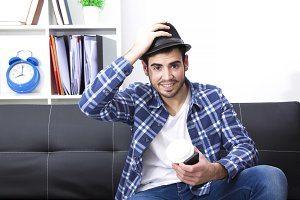 Young man at office with mobile phone and cup of coffee