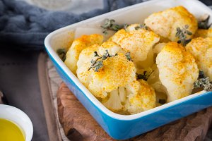 Baked cauliflower with turmeric and marjoram