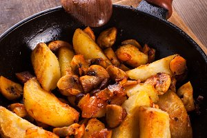 Fried potato and champignons