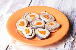Herring rolls with carrot