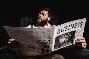businessman man reading newspaper