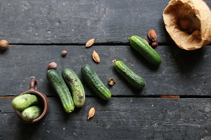 Fresh cucumbers on a old wooden kitchen table