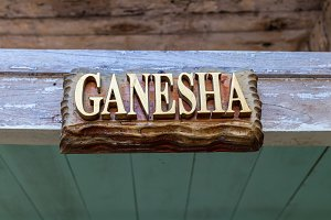 Text Ganesha on a wooden plate. Hindu God Ganesha. Ganesha Idol. Bali island.