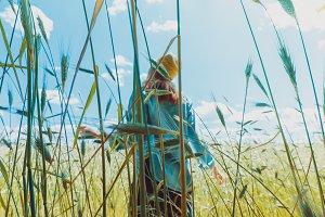 Woman farmer standing in a field