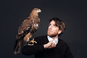 Man with a hawk sitting on his hand