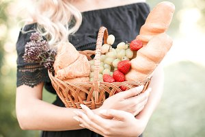 Woman with basket of fruits