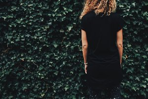 Hipster girl in a black t-shirt.back