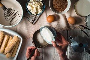 Cooking tiramisu on the white wooden table