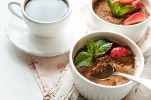 Tiramisu in the dessert bowl on the white table horizontal