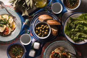 Dinner with traditional Greek dishes on the white table top view