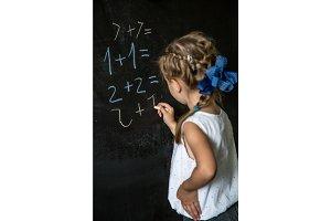 girl schoolgirl near blackboard