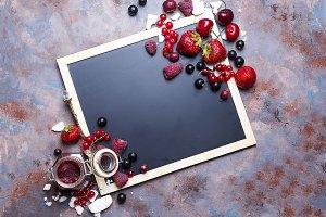 Berries jam in glass jar on table