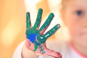 Kid hand in green paint