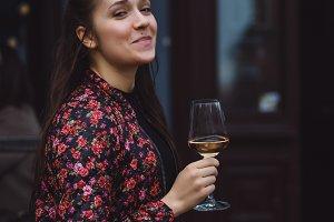 girl enjoys a glass of wine