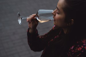 young girl drinks wine