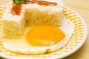plate of rice with egg and tomato sauce