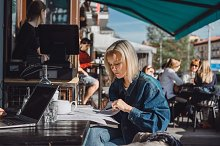 Girl freelancer working in a cafe by  in Business