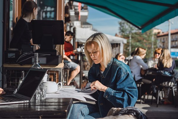 Business Stock Photos: EVA  - Girl freelancer working in a cafe