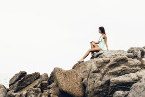 Girl sitting on the rocks