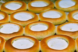 Round cheesecakes as a background.