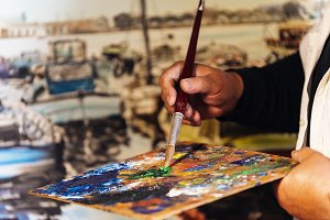 Artist painting oils in his studio.