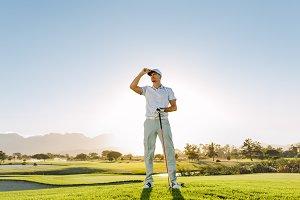 Male golfer holding golf club